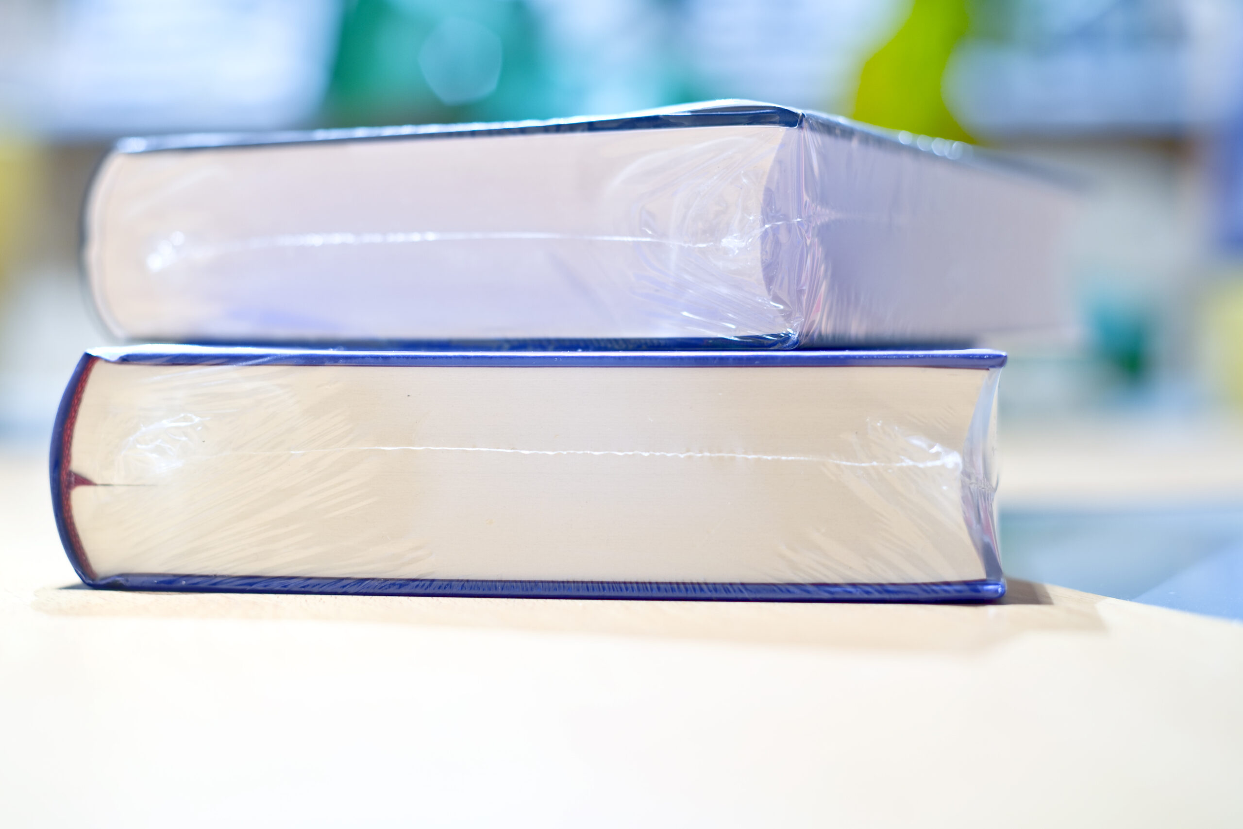 Two new Vacuum Packed Books on table